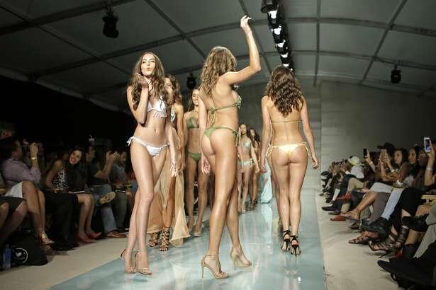 The finale of Du Aqua, Debut Lux  Collection swimwear, Thursday, July 14, 2016, in Miami Beach, Fla. (AP Photo/Alan Diaz)