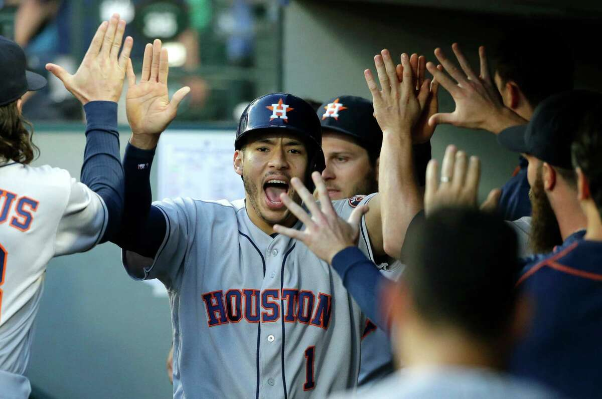 July 15: Astros 7, Mariners 3 Houston Astros' Carlos Correa is greeted in the dugout after he scored on a wild pitch by Seattle Mariners' James Paxton during the fifth inning of a baseball game, Friday, July 15, 2016, in Seattle. (AP Photo/Ted S. Warren)