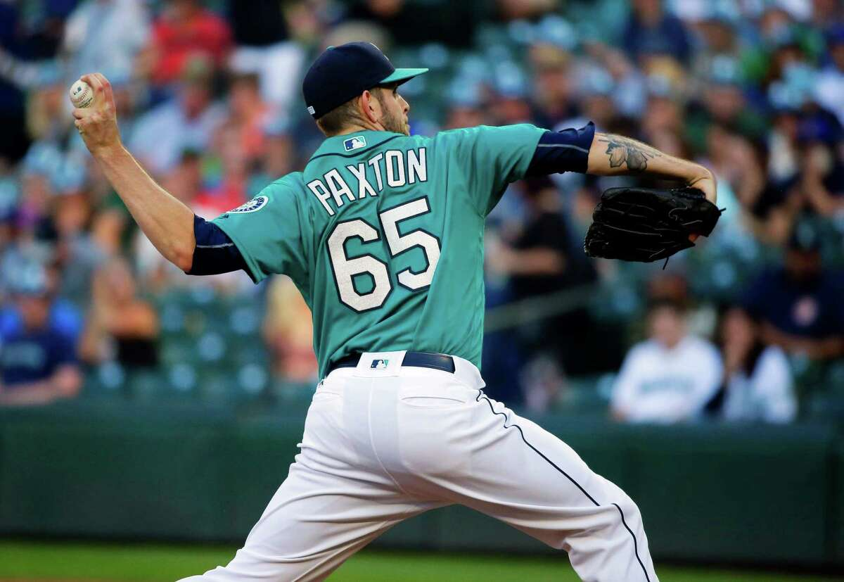 Seattle Mariners starting pitcher James Paxton throws to a Houston Astros batter during the first inning of a baseball game, Friday, July 15, 2016, in Seattle. (AP Photo/Ted S. Warren)