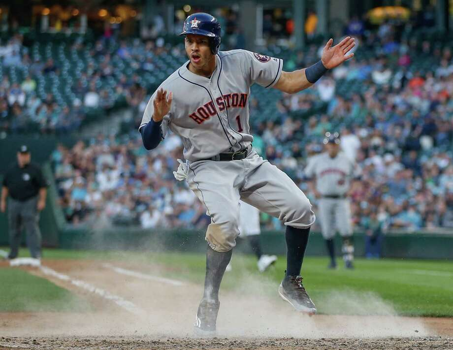 The Astros' Carlos Correa celebrates his run  on a wild pitch in the fifth inning of the win over the Mariners on Friday night. Photo: Otto Greule Jr, Stringer / 2016 Getty Images