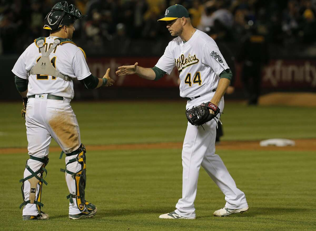 The Oakland Athletics catcher Stephen Vogt and pitcher Ryan Madson celebrate after beating the Toronto Blue Jays 8-7 at the Oakland Alameda coliseum in Oakland, California, on Fri. July 15, 2016.