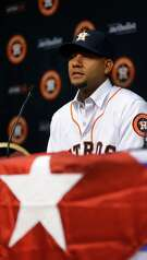 Cuban infielder Yulieski Gurriel speaks to the media after he and Houston Astros General Manager Jeff Luhnow agreed to terms, Saturday, July 16, 2016, in Houston.