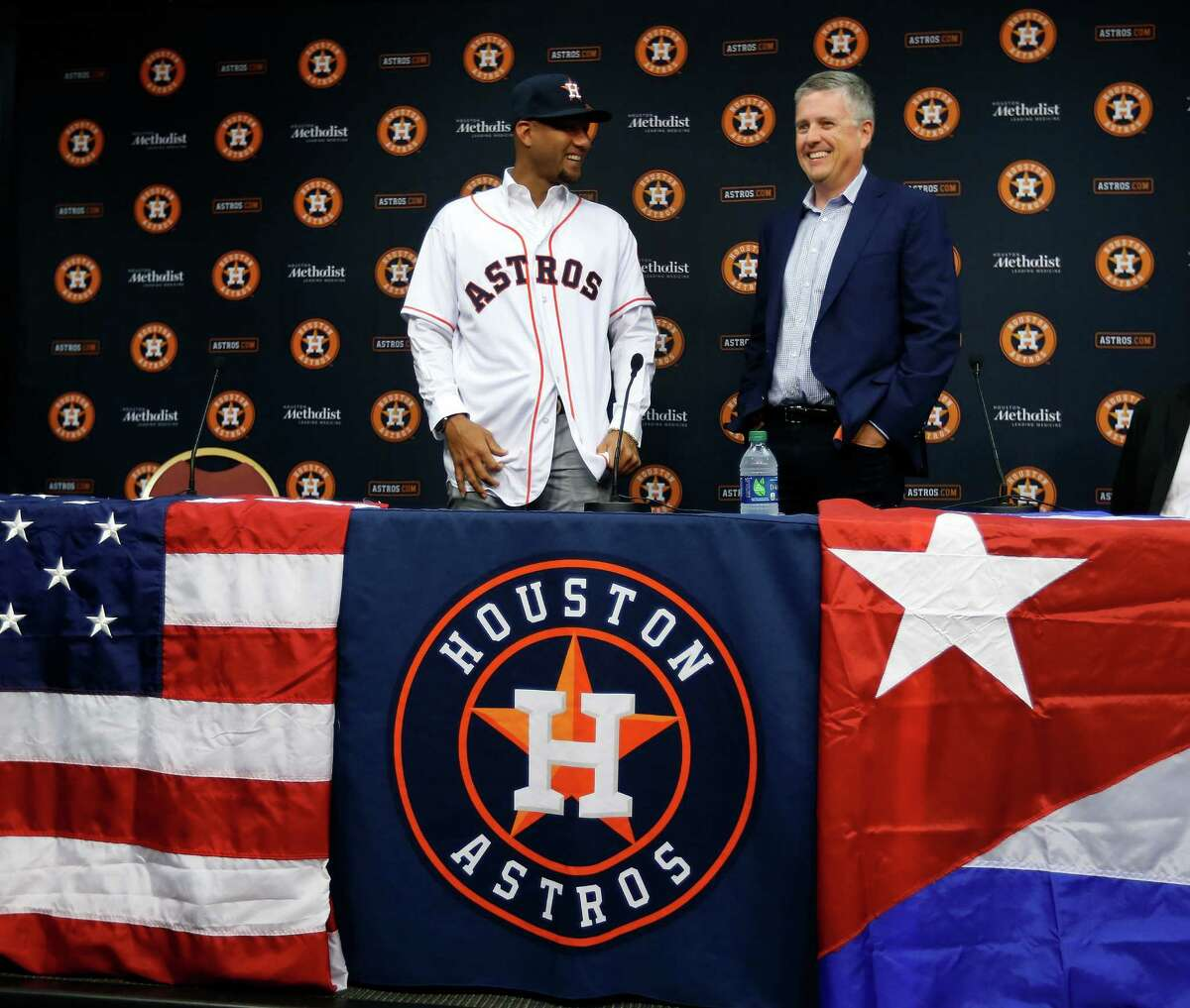 Cuban infielder Yulieski Gurriel is introduced to the media by Houston Astros General Manager Jeff Luhnow after they agreed to terms with him, Saturday, July 16, 2016, in Houston.