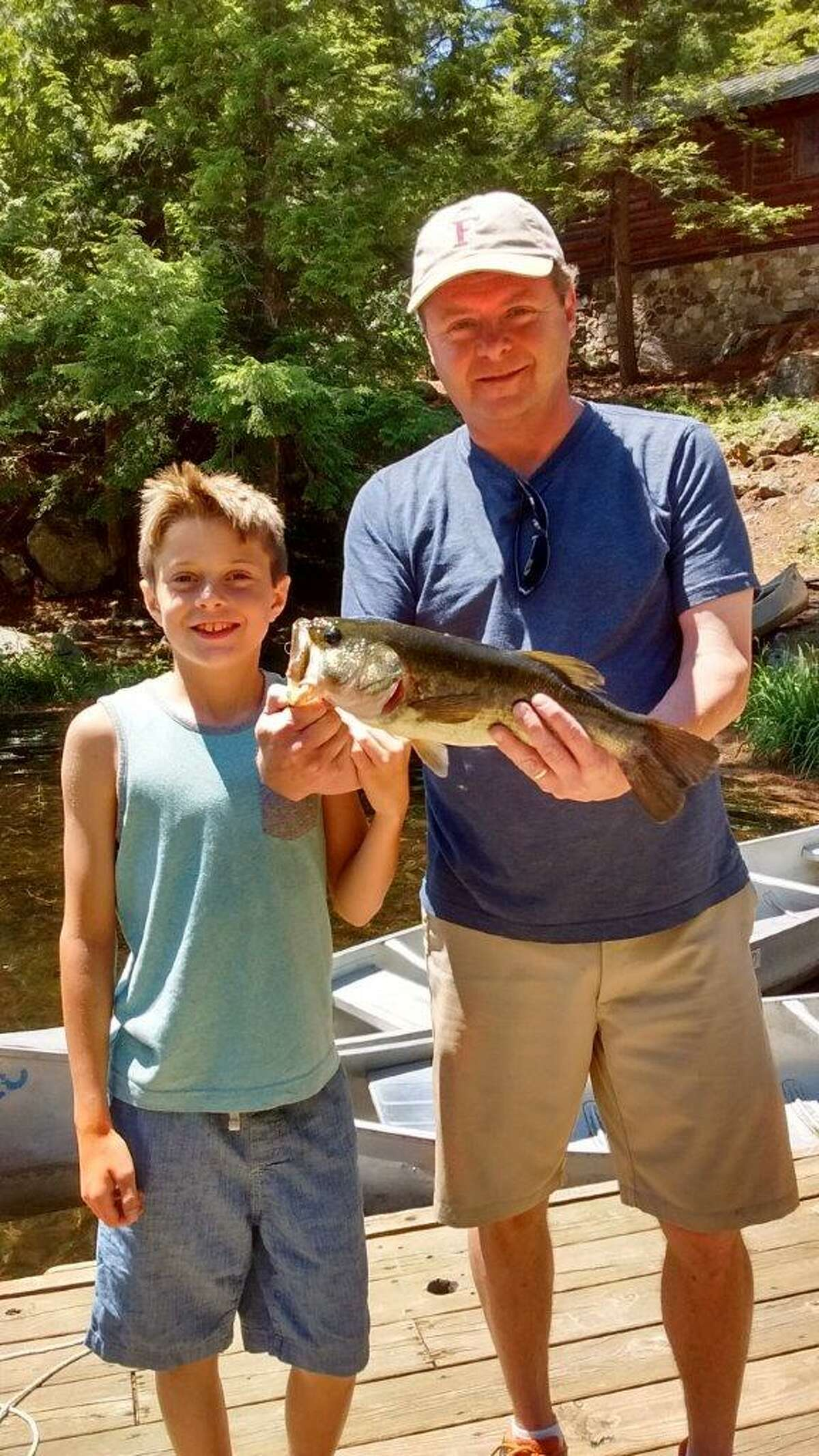 Andrew anDeusen and his father Mark show off a largemouth bass caught at Pyramid Lake on July 4.