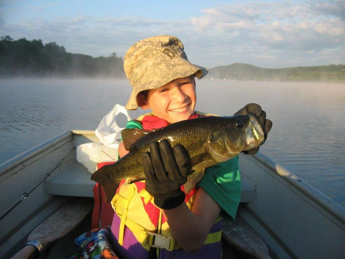 Noah Hilleboe nabs this nice largemouth bass on Cossayuna Lake before 6 a.m. It was his first cast. ORG XMIT: LsAVxHbmBdICRwJQYDVC