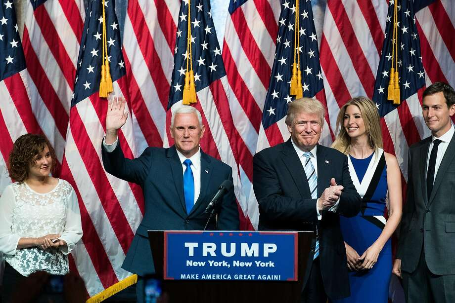 Donald Trump introduces his running mate, Indiana Gov. Mike Pence (second from left), in New York. Analysts say adding Pence to the ticket will help Trump gain support among party conservatives. Photo: Drew Angerer, Getty Images