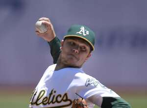 A's starting pitcher Sonny Gray throws in the first inning, as the Oakland Athletics take the Toronto Blue Jays  at the Oakland Coliseum in Oakland, California, on Sat. July 16, 2016.