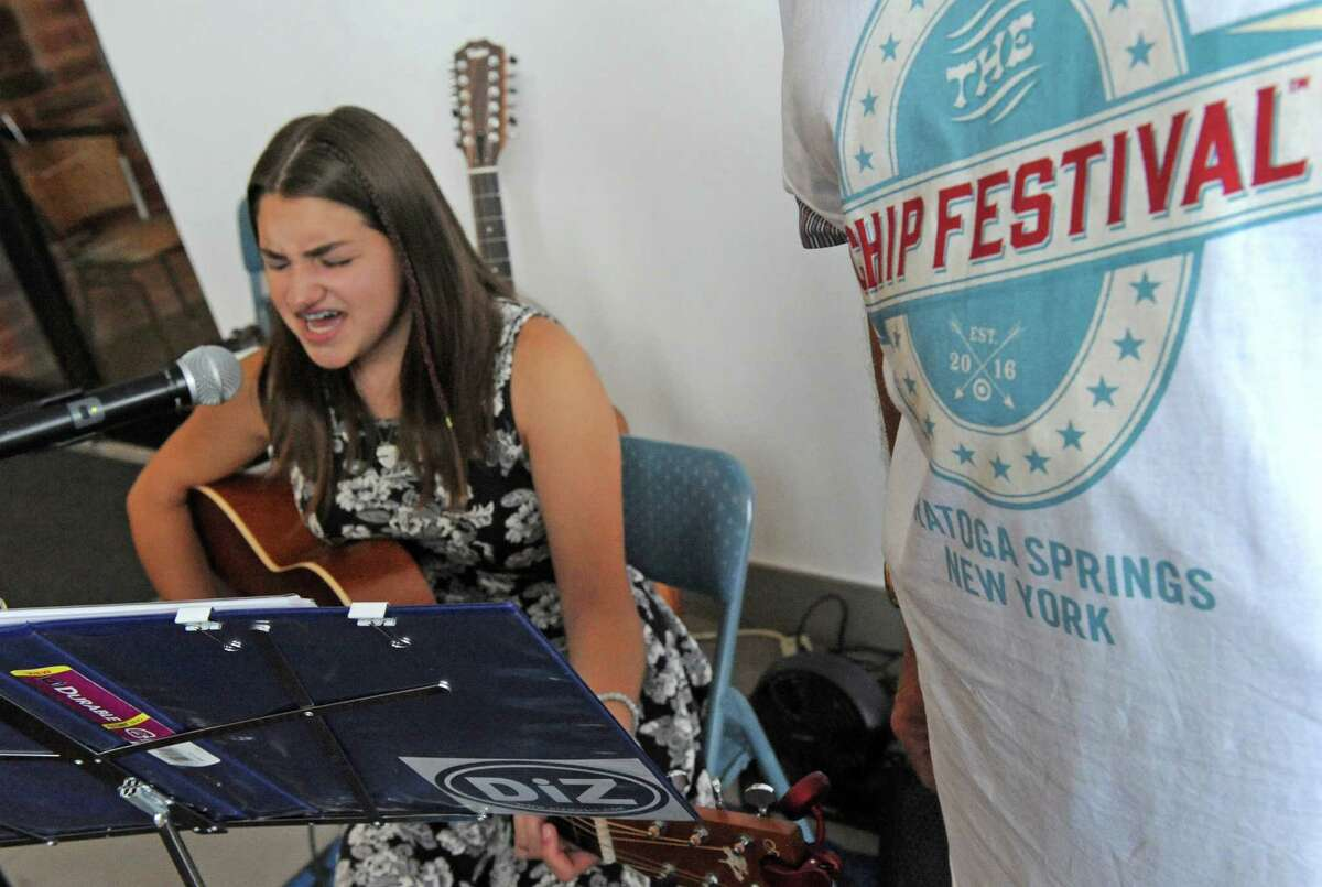 Fourteen-year-old Chole Sova of Saratoga plays guitar during the inaugural Chip Festival at the City Center on Saturday July 16, 2016 in Saratoga Springs, N.Y. (Michael P. Farrell/Times Union)