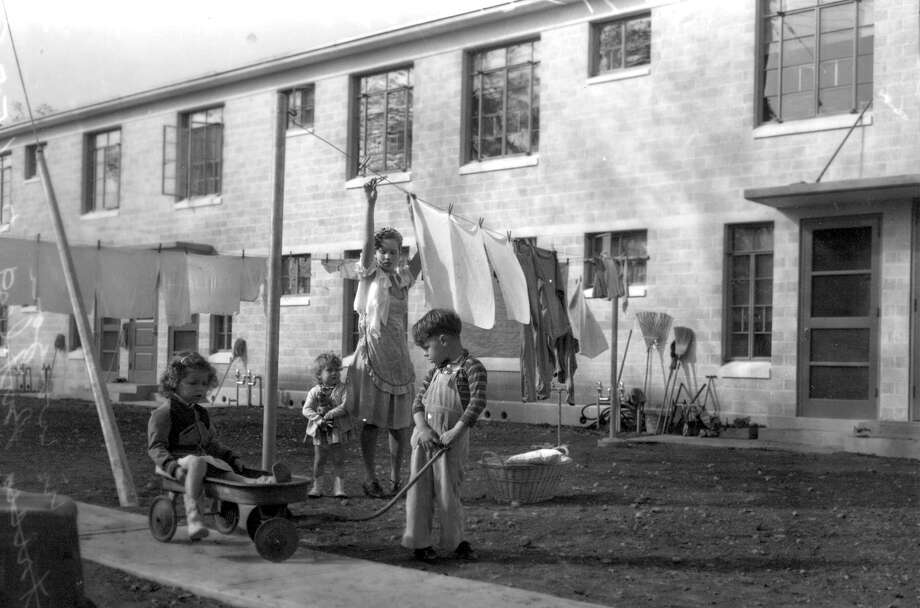 The Schwed family was the first to move into Victoria Courts, the city's largest federally funded housing complex when it opened in late 1941. At the time, projects were segregated by race; Victoria Courts at first was reserved for white families. Photo: Courtesy /UTSA Special Collections / San Antonio Light Collection