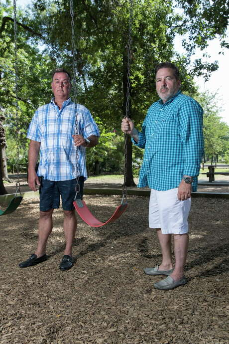 Charles Lambert (left) and Aaron hold an empty swing at Hermann Park in Houston, TX on Friday, July 8, 2016. Photo: Tim Warner, For The Chronicle / Houston Chronicle