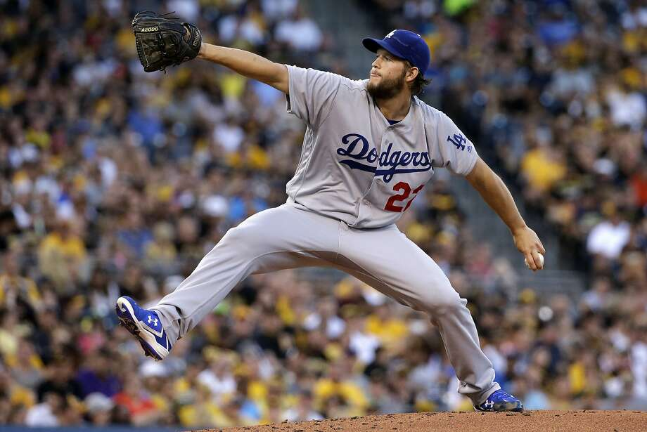 Above, the Dodgers' Clayton Kershaw throws June 26 in Pittsburgh before being shelved with a herniated disk. Left, Giants shortstop Brandon Crawford might have made a difference had he been on the National League All-Star team. Photo: Gene J. Puskar, Associated Press