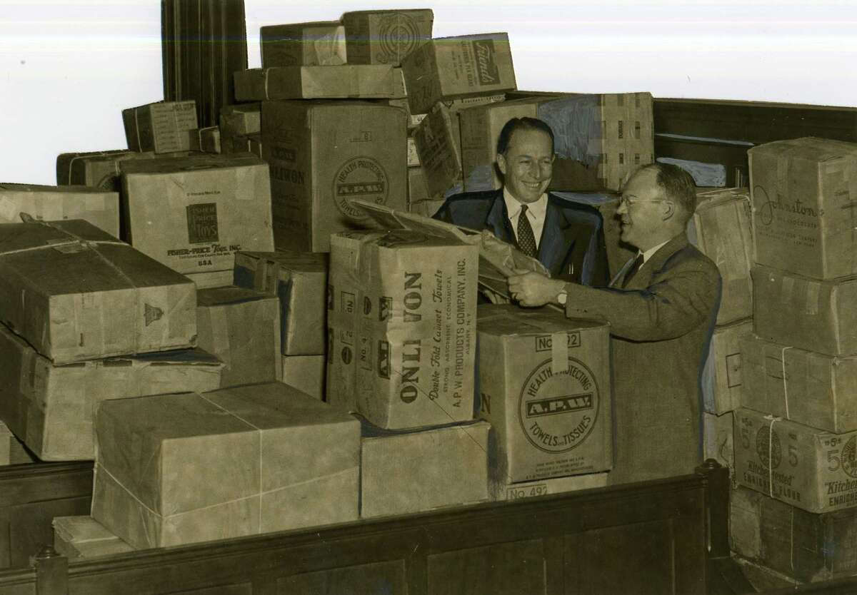 Mayor Erastus Corning and John Glenn, chairman of the toy collection campaign, with goods bound for the Dutch city of Nijmegen, undated. (Times Union archive)