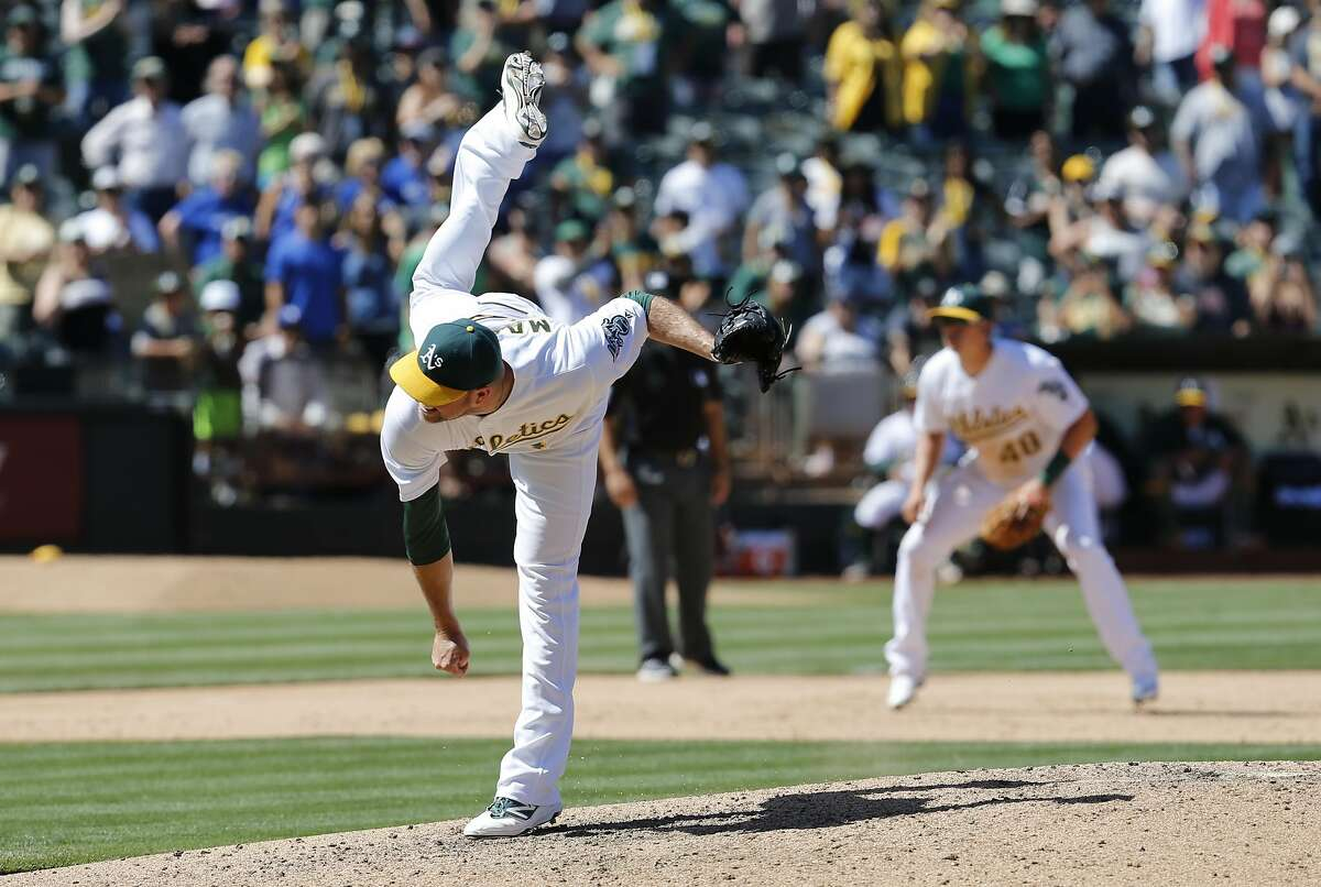 A's closer Ryan Madson, 44 throws in the 9th inning as the Oakland Athletics went on to beat the Toronto Blue Jays 5-4 at the Oakland Coliseum in Oakland, California, on Sat. July 16, 2016.