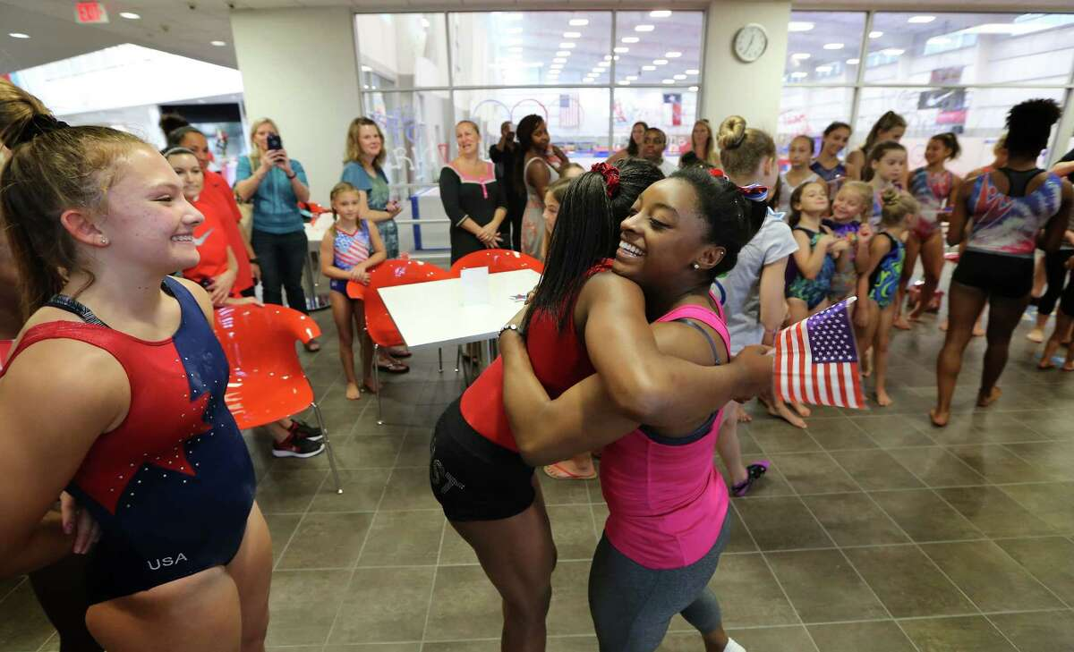 Olympic gymnast Simone Biles receives well wishes from students at the World Champions Centre, owned by her parents, on Friday in Spring. Biles begins a 10-day Olympic training camp today in Huntsville.