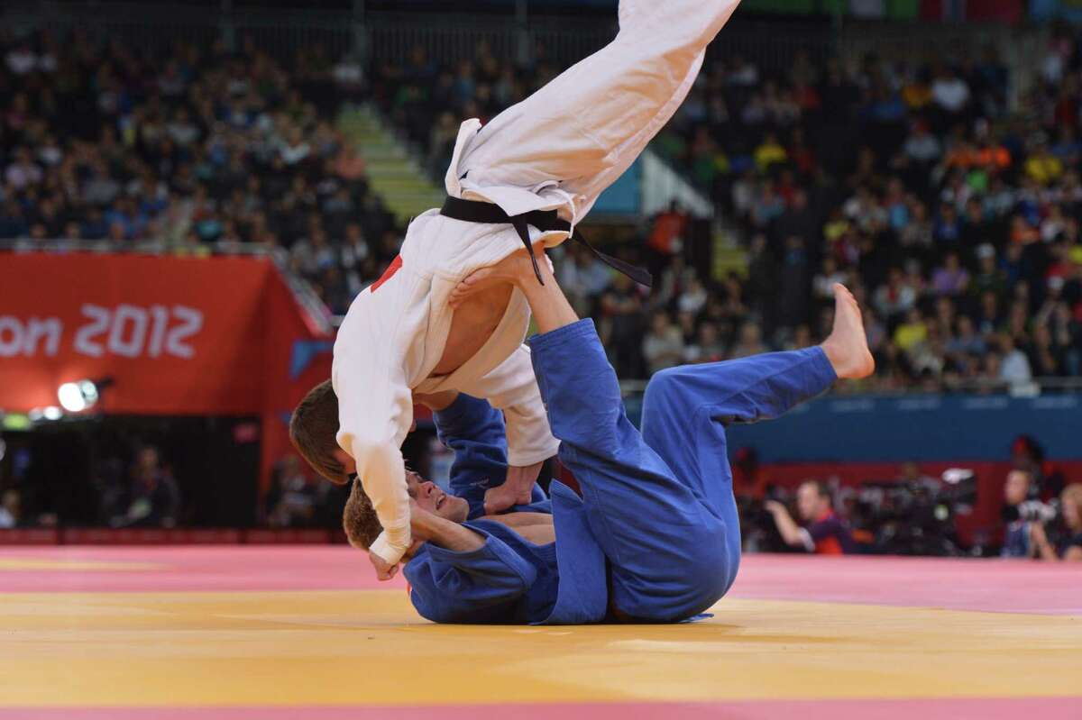 Nick Delpopolo (blue) competed in the 2012 Olympics before failing an in-competition test for marijuana. (Lou DiGesare / realjudo.net)