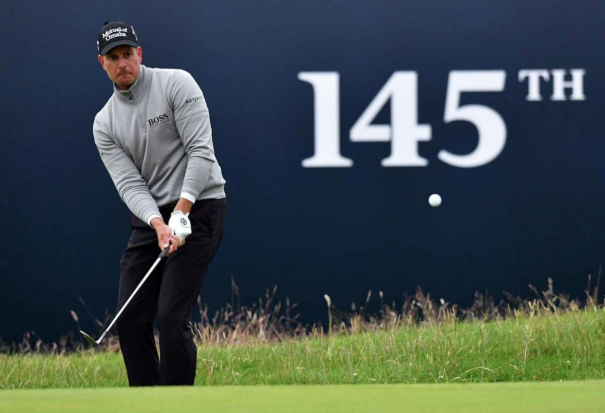 Sweden's Henrik Stenson chips onto the 18th green during his third round 68 on day three of the 2016 British Open Golf Championship at Royal Troon in Scotland on July 16, 2016. Sweden's Henrik Stenson leads the British Open by a single shot from Phil Mickelson after the third round following his superb 68 on Saturday. Stenson, bidding to win his first major at the age of 40, had five birdies and two bogeys in his three-under-par round to move to 12-under for the championship. / AFP PHOTO / Ben STANSALL / RESTRICTED TO EDITORIAL USEBEN STANSALL/AFP/Getty Images