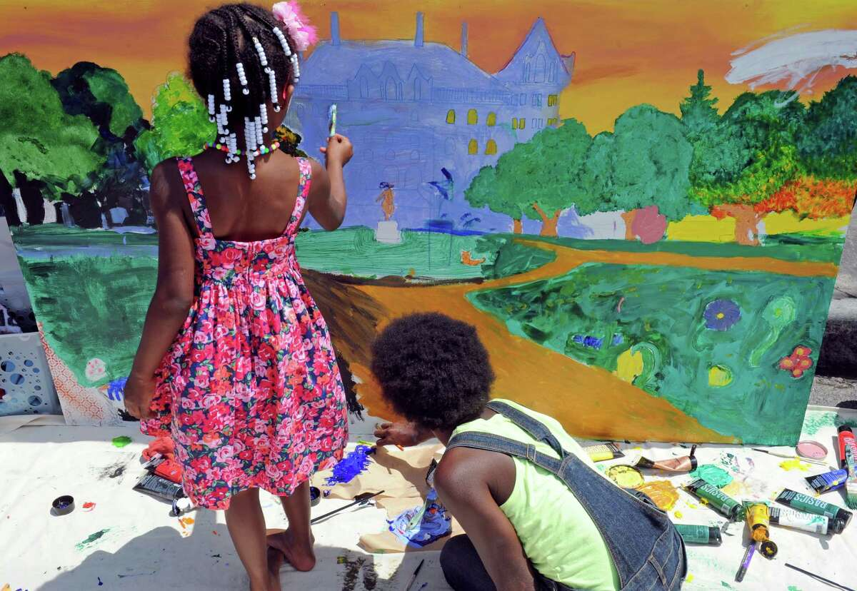 Art On Lark, Actually- Six-year-old Symphony Robinson, left, and Zoe Harrison, 13, work on a painting of the State Capitol at the Albany Center Galley booth during the 2016 Art on Lark presented by the Lark Street Business Improvement District on Saturday July 16, 2016 in Albany, N.Y. (Michael P. Farrell/Times Union)
