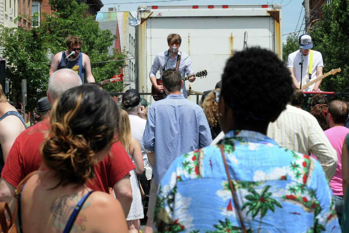 The band Coupons performs during the 2016 Art on Lark presented by the Lark Street Business Improvement District on Saturday July 16, 2016 in Albany, N.Y. (Michael P. Farrell/Times Union)
