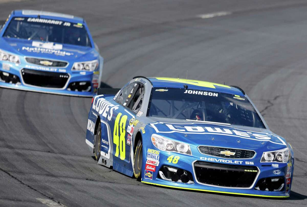 Jimmie Johnson (48) holds a lead over Alex Bowman (88), driving for Dale Earnhardt Jr., during practice at New Hampshire Motor Speedway for Sunday's NACAR Sprint Cup Series auto race Saturday, July 16, 2016, in Loudon, N.H. (AP Photo/Jim Cole) ORG XMIT: NHJC104