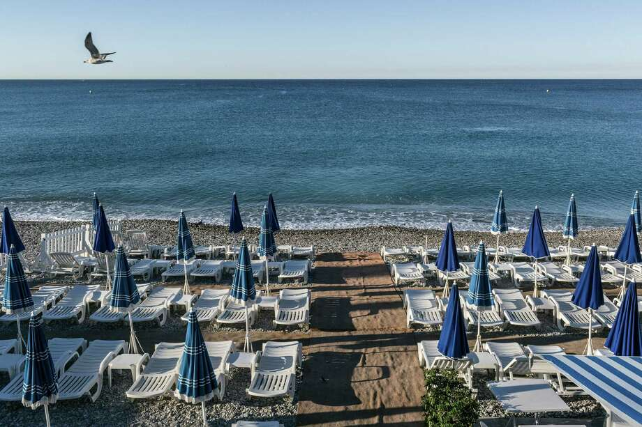 Empty chairs dot the beach at the Promenade des Anglais where a man drove a 19-ton truck through a crowd celebrating Bastille Day in Nice, France, last week. Photo: MAURICIO LIMA, STR / NYTNS