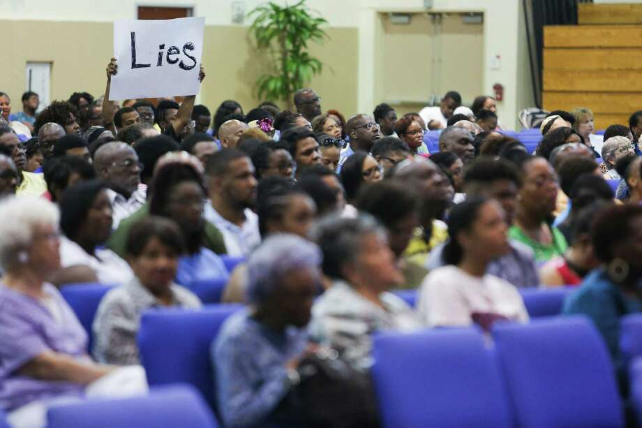 """A man holds up a sign the reads, """"Lies"""" as members of the law enforcement community participate in a Courageous Conversation town hall to address police violence against minority communities at The Kingdom Builder's Center Saturday, July 16, 2016. Photo: Michael Ciaglo, Houston Chronicle / © 2016  Houston Chronicle"""