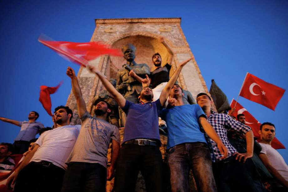 Turkish residents gather at a pro-government rally in Istanbul's Taksim square on Saturday, the day after an attempted coup left nearly 200 people dead and scores of others wounded. Photo: Emrah Gurel, STR / Copyright 2016 The Associated Press. All rights reserved. This material may not be published, broadcast, rewritten or redistribu