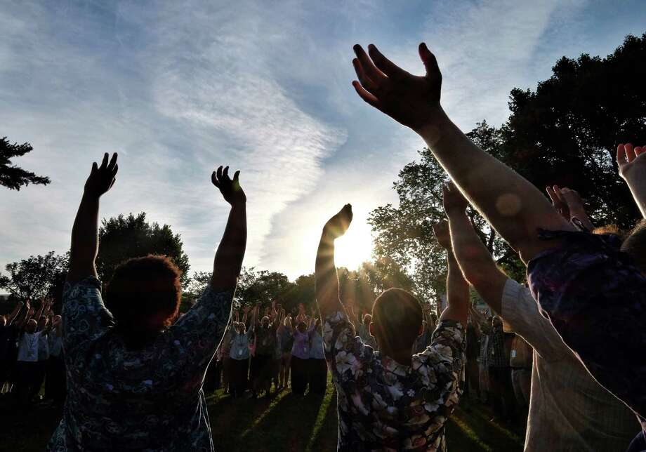 Together 2016, a 12-hour revival on the National Mall Saturday, began with a sunrise prayer (pictured) and included appearances by some of the biggest names in Christian music, as well as preachers and poets. The day even featured a video greeting from Pope Francis.  Photo: Jahi Chikwendiu, The Washington Post / (c) 2016, The Washington Post