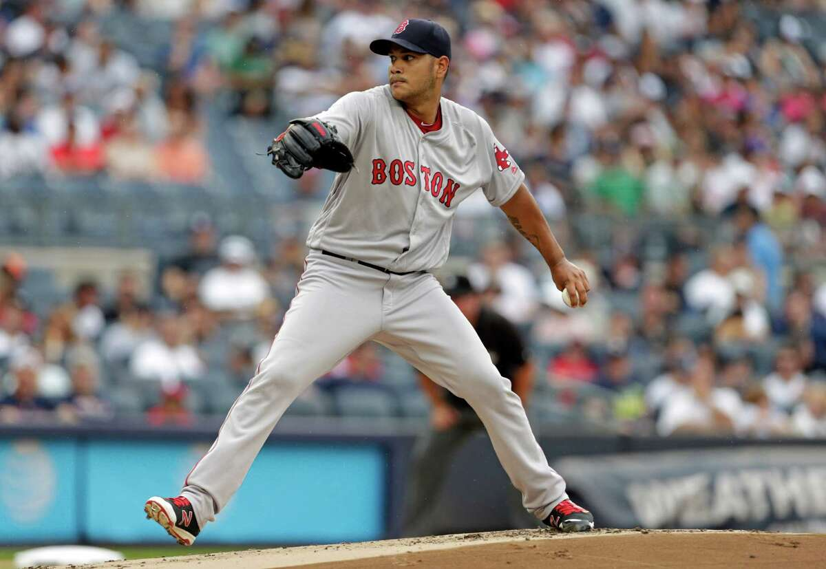 NEW YORK, NY - JULY 16: Eduardo Rodriguez #52 of the Boston Red Sox pitches against the New York Yankees during the first inning at Yankee Stadium on July 16, 2016 in the Bronx borough of New York City. (Photo by Adam Hunger/Getty Images) ORG XMIT: 607681623