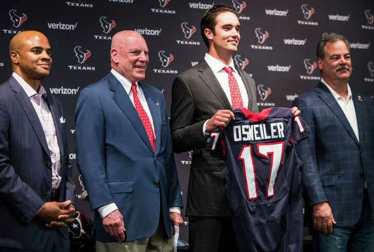 Houston Texans quarterback Brock Osweiler stands with general manager Rick Smith, far left, owner Bob McNair and Cal McNair, far right, as he is introduced during a news conference at NRG Stadium on Thursday, March 10, 2016, in Houston. The Texans introduced four free agent signees Thursday, including Osweiler, running back Lamar Miller, center, Tony Bergstrom and guard Jeff Allen. ( Brett Coomer / Houston Chronicle )