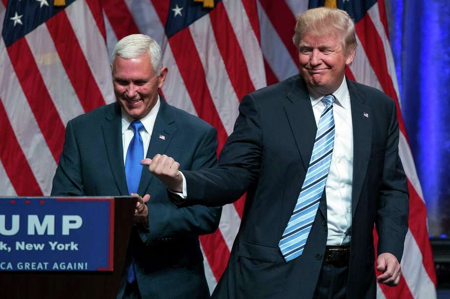 """Republican presidential candidate Donald Trump, right, announced Gov. Mike Pence, R-Ind., as his vice presidential running mate on Saturday in New York. Trump called Pence """"my partner"""" and his first and best choice to join him despite reports that Trump was uncomfortable with the decision until the end. Photo: Evan Vucci, STF / Copyright 2016 The Associated Press. All rights reserved. This material may not be published, broadcast, rewritten or redistribu"""
