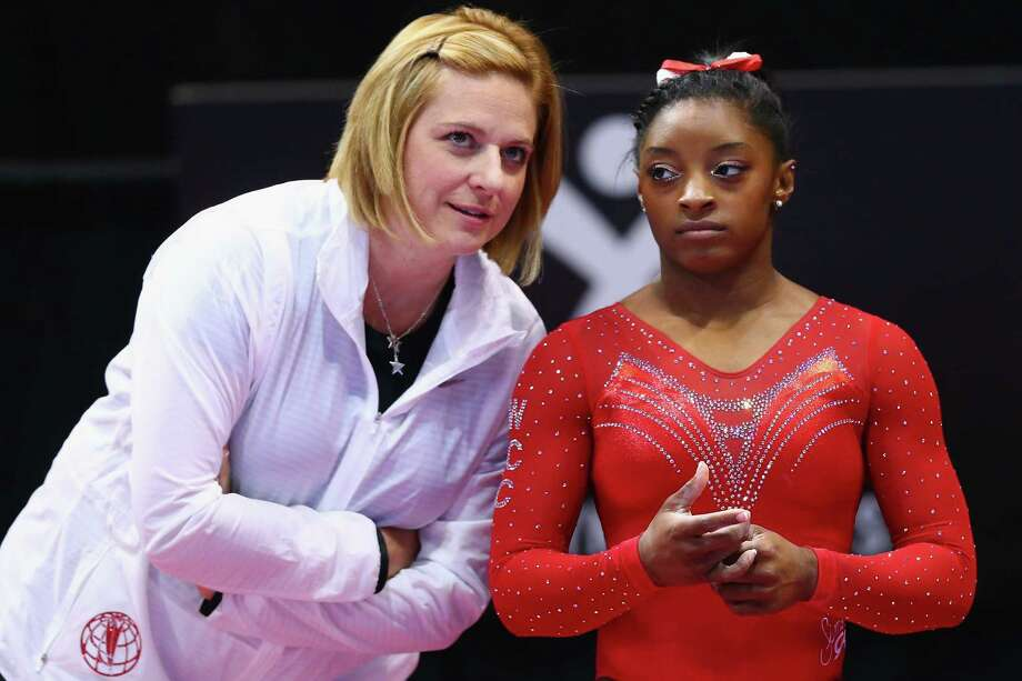 Simone Biles, right, and Aimee Boorman don't practice the usual coach-athlete relationship. Both have grown together since meeting and now head to Rio next month. Photo: Maddie Meyer, Staff / 2016 Getty Images