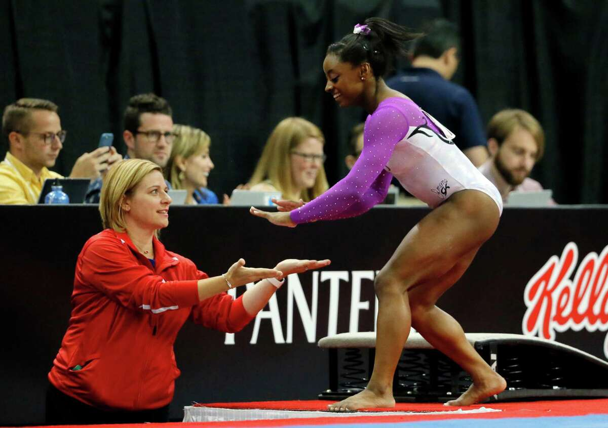 Simone Biles, right, and Aimee Boorman don't practice the usual coach-athlete relationship. Both have grown together since meeting and now head to Rio next month.