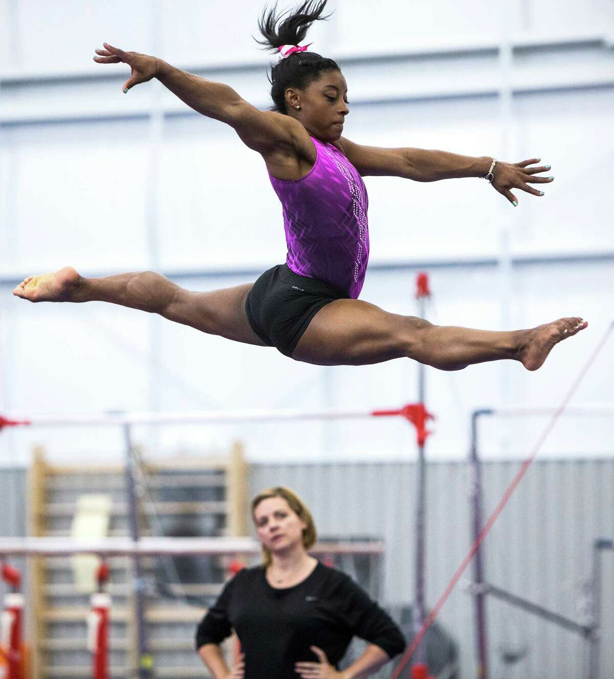 Under the watchful eye of coach Aimee Boorman, Simone Biles has won three consecutive world all-around championships and has her sights on Olympic gold.
