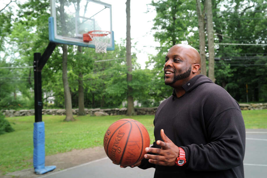 Marvin Cole, of Stamford, plays basketball at Barrett Field in Stamford, Conn. July 7, 2016. Even on one of hottest days of the year, Cole said he prefers to exercise outdoors. Photo: Ned Gerard / Hearst Connecticut Media / Connecticut Post