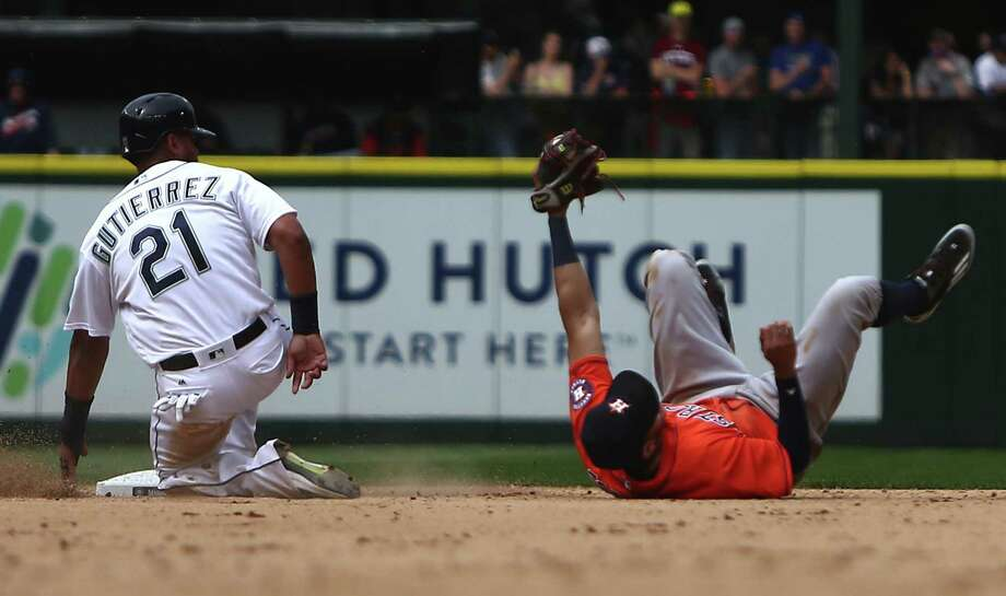 Astros shortstop Carlos Correa holds on to the ball after tagging out Seattle's Franklin Gutierrez, who was trying to reach second base in the seventh inning. Photo: Sy Bean, MBR / Seattle Times