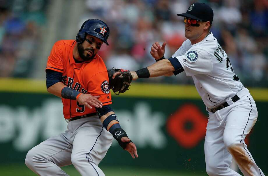 Mariners shortstop Shawn O'Malley, right, doesn't let Astros first baseman Marwin Gonzalez advance to third on a bunt attempt by Jose Altuve with no outs in the ninth inning Saturday at Safeco Field in Seattle. Photo: Otto Greule Jr, Stringer / 2016 Getty Images