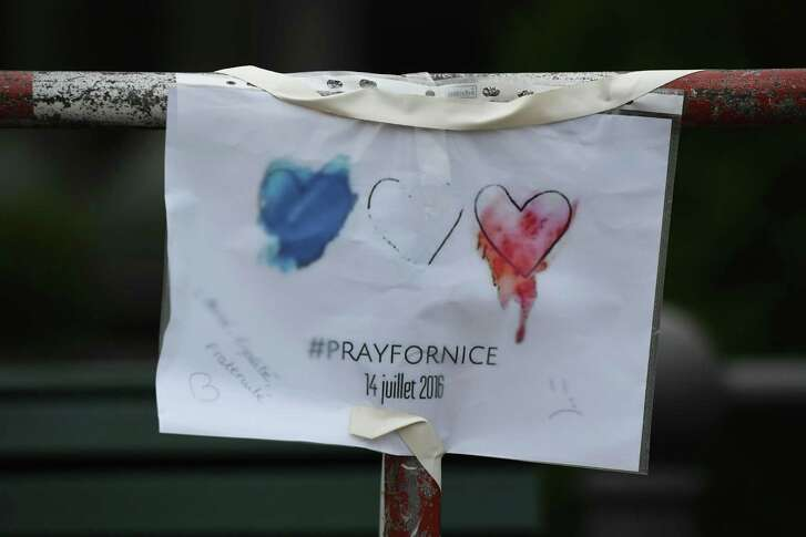 """A """"Pray for Nice"""" message is seen hung in front of the French embassy in Berlin on Friday following the deadly attacks in Nice."""