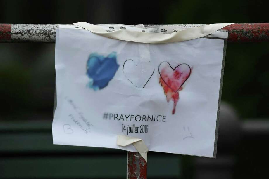 "A ""Pray for Nice"" message is seen hung in front of the French embassy in Berlin on Friday following the deadly attacks in Nice.  Photo: JOHN MACDOUGALL, Staff / AFP or licensors"