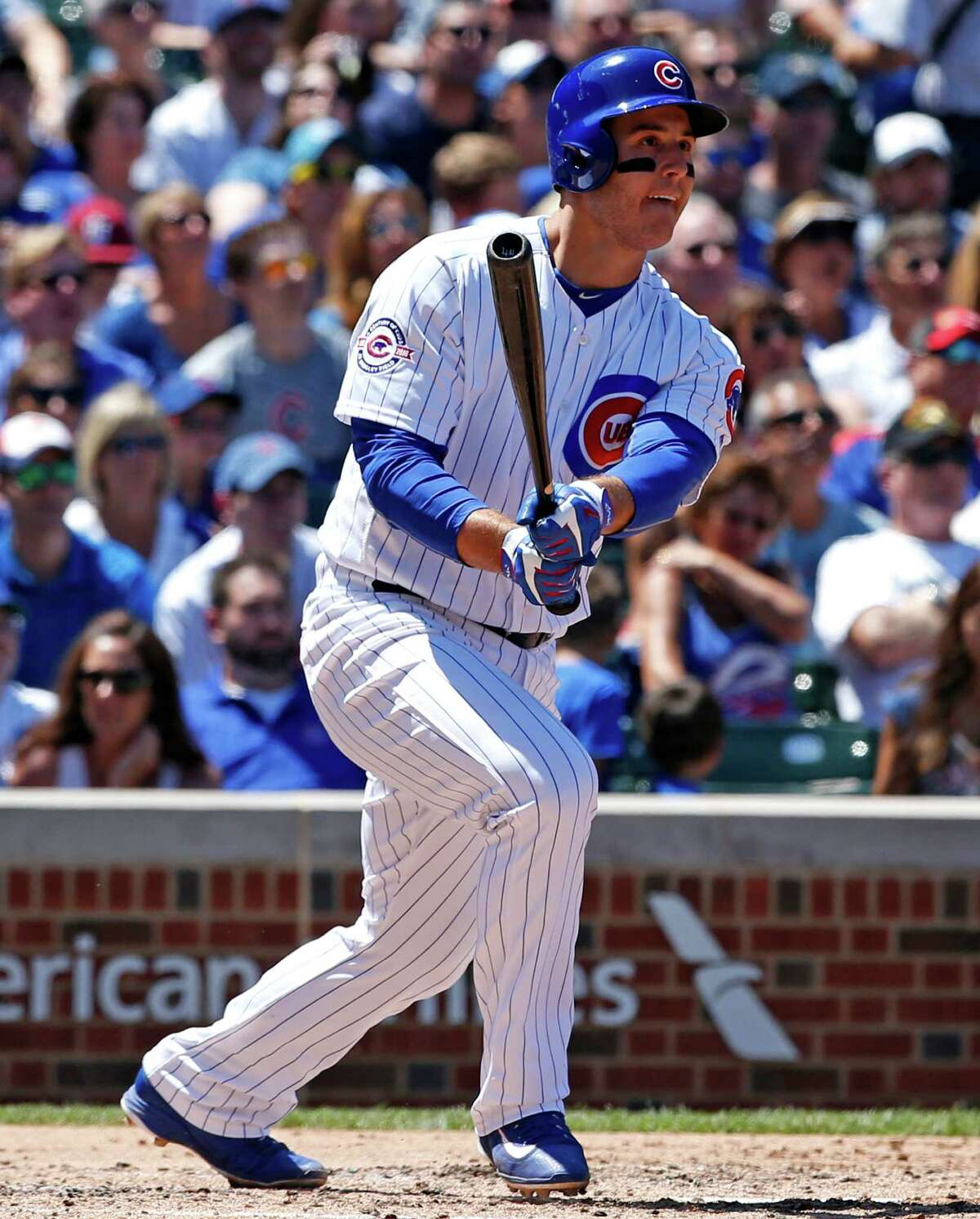 Chicago Cubs' Anthony Rizzo watches after hitting a two-run double during the third inning of an interleague baseball game against the Texas Rangers in Chicago, Saturday, July 16, 2016. (AP Photo/Nam Y. Huh) ORG XMIT: CXC104