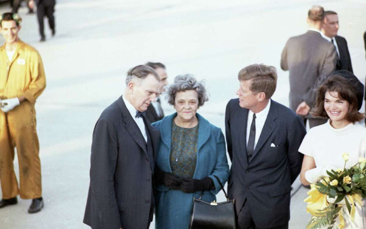 The Kennedys arrive at the airport in Houston on Nov. 21, 1963, along with Congressman Albert Thomas with his wife Lera.