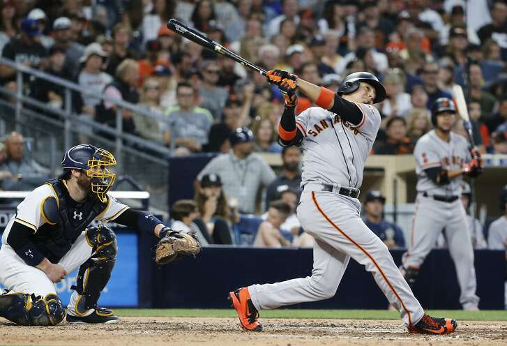 San Francisco Giants' Ramiro Pena follows through on a home run against the San Diego Padres during the sixth inning of a baseball game Saturday, July 16, 2016, in San Diego. (AP Photo/Lenny Ignelzi)