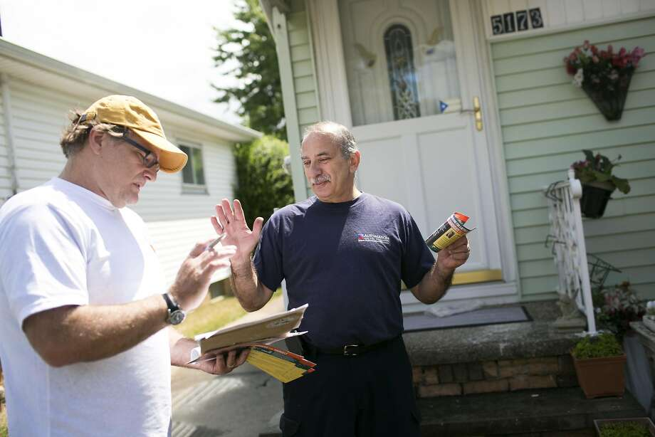 David Sheagley (left) visits with Dan Rivera while canvassing for Hillary Clinton in Cleveland. Photo: Maddie McGarvey, Special To The Chronicle