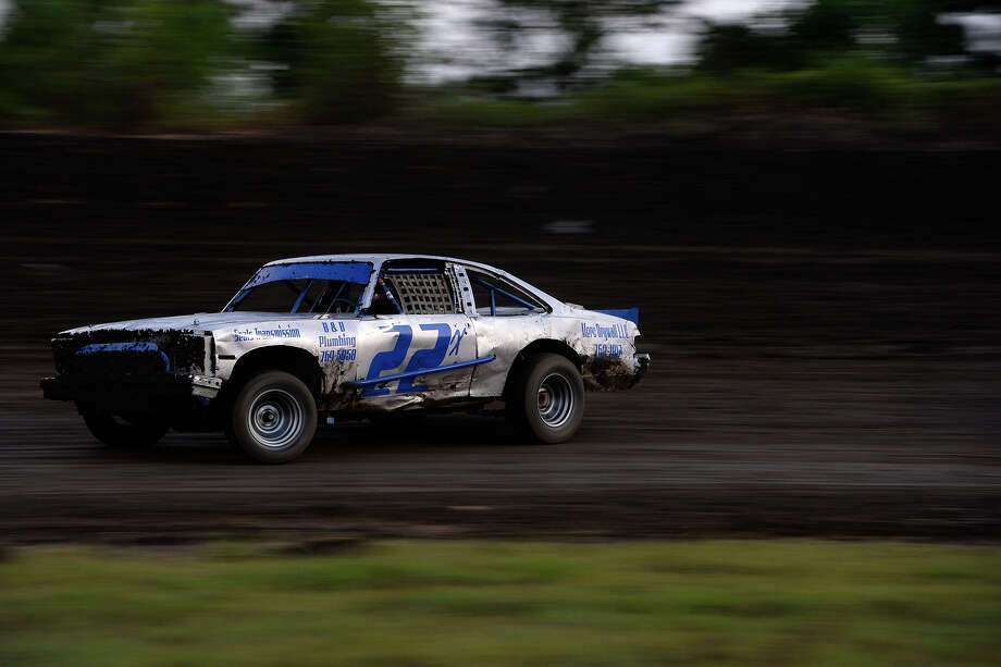 A street stock car slides through the muddy turn at the Golden Triangle Raceway Park on Friday evening. The evening saw the return of the SUPR Late Model class to the quarter mile dirt oval track. Photo taken Friday 7/15/16 Ryan Pelham/The Enterprise Photo: Ryan Pelham / ©2016 The Beaumont Enterprise/Ryan Pelham