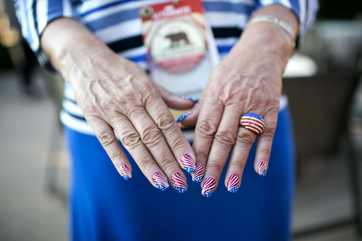 Liz Ritchie holds up her patriotic nails at a welcome reception for California delegates at the Kalahari Resort in Sandusky, OH on Saturday, July 16, 2016.