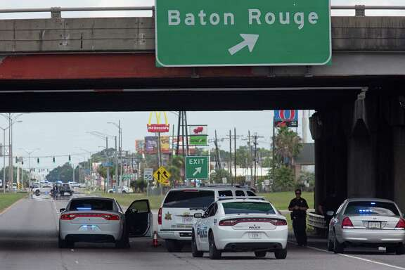 Baton Rouge Police block Airline Highway after police were shot in Baton Rouge, La., Sunday, July 17, 2016.  At least three officers are confirmed dead and at least three others wounded after the shooting, a sheriff's office spokeswoman said Sunday.  (AP Photo/Max Becherer)