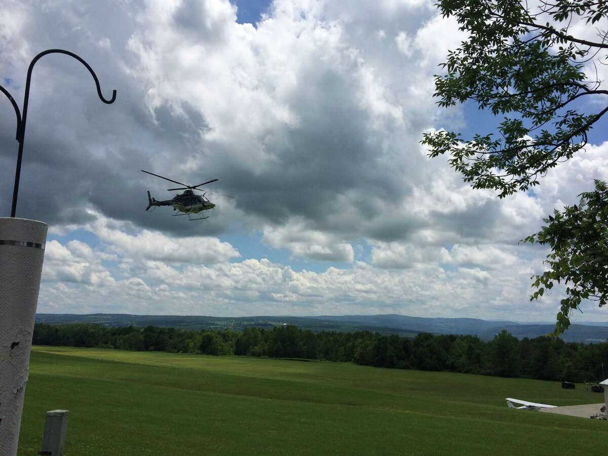 A State Police helicopter takes off to survey the scene of a fatal plane crash in Esperance, Schoharie County July 17, 2016 (Lauren Stanforth)