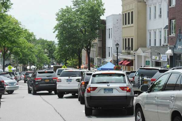 The annual Sidewalk Sales organized by the Greenwich Chamber of Commerce brought bumper to bumper traffic jams to Greenwich Avenue, Greenwich, Conn., Thursday, July 14, 2016. According to the Greenwich Chamber of Commerce website, over 120 businesses are participating in the central Greenwich sales event that features merchants offering deep discounts on brand items under small tents placed outside their stores. The event runs from 10 a.m. to 6 p.m. on Friday and Saturday, and from 11 a.m. to 5 p.m. on Sunday, the final day of the sales.