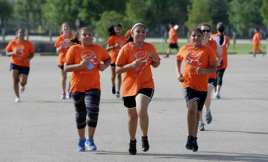 Students jog during the Memorial Hermann  H.A.P.P.Y. Summer Boot Camp held at the Nimitz Clinic, 2003 W. W. Thorne Blvd., Monday, July 11, 2016, in Houston.  ( Melissa Phillip / Houston Chronicle ) Photo: Melissa Phillip, Staff / © 2016 Houston Chronicle