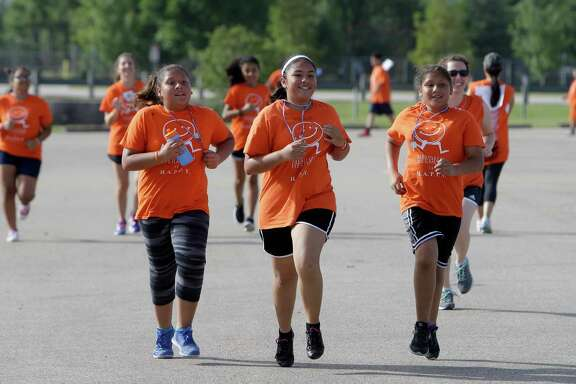 Students jog during the Memorial Hermann  H.A.P.P.Y. Summer Boot Camp held at the Nimitz Clinic, 2003 W. W. Thorne Blvd., Monday, July 11, 2016, in Houston.  ( Melissa Phillip / Houston Chronicle )