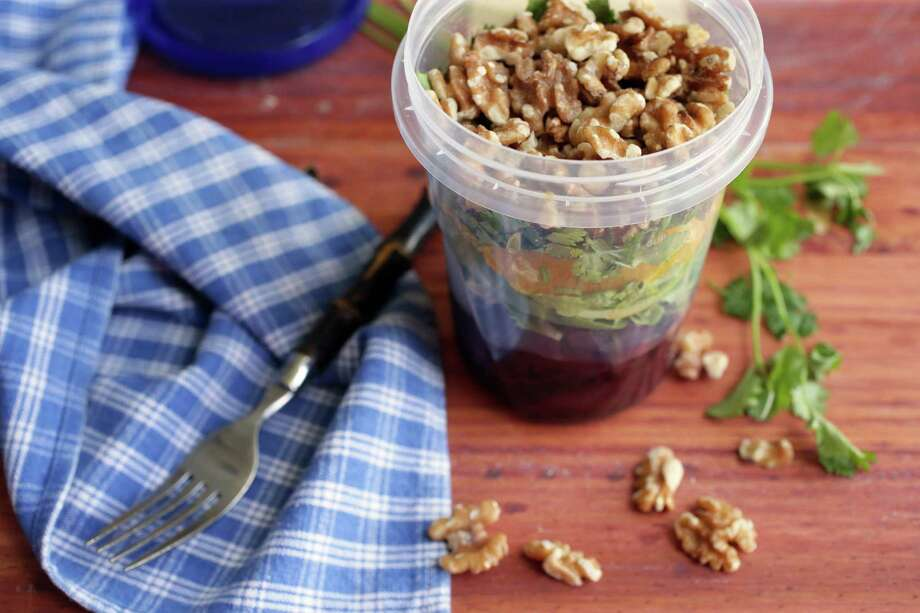 Walnuts can help you maintain a healthy weight. Try a beet, orange and arugula salad topped with walnuts. Photo: Cristina M. Fletes, MBR / St. Louis Post-Dispatch
